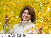 Купить «Woman with curly hair near autumn birch», фото № 26529894, снято 11 октября 2013 г. (c) Володина Ольга / Фотобанк Лори