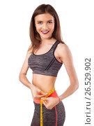 Happy young woman with measure tape, fitness concept (2017 год). Редакционное фото, фотограф VictorStudio / Фотобанк Лори