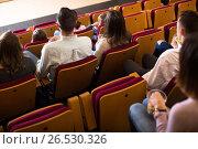 Купить «Numerous group expecting movie to begin», фото № 26530326, снято 3 декабря 2016 г. (c) Яков Филимонов / Фотобанк Лори