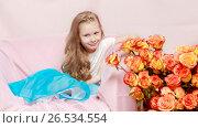 Купить «A beautiful little girl with long, light, curly hair, in a blue», фото № 26534554, снято 27 апреля 2017 г. (c) Сергей Колесников / Фотобанк Лори