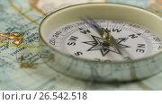 Купить «Compass on the map», видеоролик № 26542518, снято 10 мая 2017 г. (c) Дмитрий Брусков / Фотобанк Лори