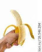 Man hand holding banana isolated. Стоковое фото, фотограф Dmitriy Melnikov / Фотобанк Лори