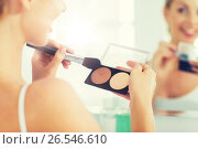 Купить «woman with makeup brush and foundation at bathroom», фото № 26546610, снято 13 февраля 2016 г. (c) Syda Productions / Фотобанк Лори