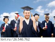 Купить «happy student with diploma celebrating graduation», фото № 26546762, снято 24 сентября 2016 г. (c) Syda Productions / Фотобанк Лори