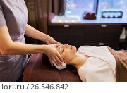 Купить «woman having face and head massage at spa parlor», фото № 26546842, снято 26 января 2017 г. (c) Syda Productions / Фотобанк Лори
