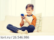 Купить «boy with smartphone texting or playing at home», фото № 26546986, снято 24 октября 2015 г. (c) Syda Productions / Фотобанк Лори