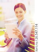 Купить «businesswoman reading notes in notepad outdoors», фото № 26547114, снято 10 мая 2015 г. (c) Syda Productions / Фотобанк Лори