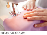 Купить «sewing machine presser foot stitching fabric», фото № 26547294, снято 29 сентября 2016 г. (c) Syda Productions / Фотобанк Лори