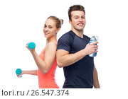 Купить «sportive man and woman with dumbbell and water», фото № 26547374, снято 2 марта 2017 г. (c) Syda Productions / Фотобанк Лори