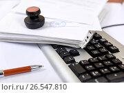 Купить «Рабочее место в офисе. Документы, клавиатура, печать и ручка», эксклюзивное фото № 26547810, снято 16 июня 2017 г. (c) Юрий Морозов / Фотобанк Лори