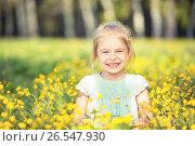 Купить «Happy little girl on blooming meadow», фото № 26547930, снято 11 мая 2016 г. (c) Sergey Borisov / Фотобанк Лори