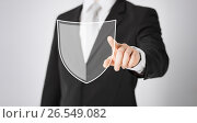 Купить «man pointing finger at antivirus program icon», фото № 26549082, снято 21 марта 2013 г. (c) Syda Productions / Фотобанк Лори