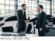 Купить «Top sales manager and customer at dealership showroom», фото № 26551762, снято 2 июня 2017 г. (c) Andrejs Pidjass / Фотобанк Лори