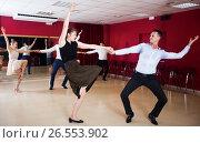 Купить «Couples enjoying active boogie-woogie», фото № 26553902, снято 24 мая 2017 г. (c) Яков Филимонов / Фотобанк Лори