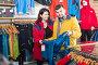 Couple deciding on track jacket, фото № 26553950, снято 8 марта 2017 г. (c) Яков Филимонов / Фотобанк Лори