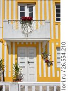 Купить «Striped colored houses, Costa Nova, Beira Litoral, Portugal, Europe», фото № 26554210, снято 10 июня 2017 г. (c) Знаменский Олег / Фотобанк Лори