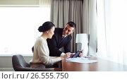Купить «business team with papers and tablet pc at hotel», видеоролик № 26555750, снято 16 июля 2019 г. (c) Syda Productions / Фотобанк Лори