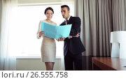 Купить «business team with papers working at hotel room», видеоролик № 26555758, снято 16 июля 2019 г. (c) Syda Productions / Фотобанк Лори