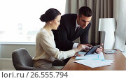 Купить «business team with papers and tablet pc at hotel», видеоролик № 26555794, снято 25 июня 2019 г. (c) Syda Productions / Фотобанк Лори
