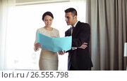 Купить «business team with papers working at hotel room», видеоролик № 26555798, снято 7 июня 2017 г. (c) Syda Productions / Фотобанк Лори