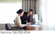 Купить «business team with papers and tablet pc at hotel», видеоролик № 26555814, снято 27 мая 2017 г. (c) Syda Productions / Фотобанк Лори