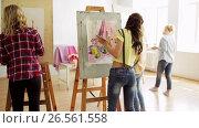 Купить «students with easels painting at art school», видеоролик № 26561558, снято 15 октября 2019 г. (c) Syda Productions / Фотобанк Лори