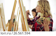 Купить «students with easels painting at art school», видеоролик № 26561594, снято 27 мая 2017 г. (c) Syda Productions / Фотобанк Лори