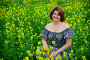 Beautiful middle-aged woman sitting in flowering meadow, фото № 26565114, снято 19 июня 2017 г. (c) Володина Ольга / Фотобанк Лори