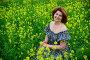 Beautiful middle-aged woman sitting in flowering meadow, фото № 26565122, снято 19 июня 2017 г. (c) Володина Ольга / Фотобанк Лори