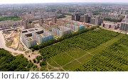 Купить «Aerial view of new residential area in the russian city - Voronezh. June 1, 2017 Russia. 4K», видеоролик № 26565270, снято 1 июня 2017 г. (c) ActionStore / Фотобанк Лори