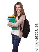 Young happy student with notebooks (2017 год). Редакционное фото, фотограф VictorStudio / Фотобанк Лори