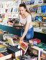 Woman buying textbooks, фото № 26565542, снято 9 мая 2017 г. (c) Яков Филимонов / Фотобанк Лори