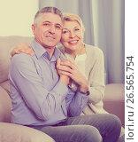 Купить «positive mature married couple in house are warmly reconciled after quarrel», фото № 26565754, снято 16 августа 2018 г. (c) Яков Филимонов / Фотобанк Лори