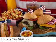 Купить «Hot dog and hamburgers decorated with 4th july theme», фото № 26569366, снято 10 февраля 2017 г. (c) Wavebreak Media / Фотобанк Лори