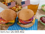 Купить «Hamburgers decorated with 4th july theme», фото № 26569402, снято 10 февраля 2017 г. (c) Wavebreak Media / Фотобанк Лори