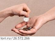Купить «Hand putting coins in the palm of another person, closeup», фото № 26572266, снято 5 февраля 2016 г. (c) Павел Родимов / Фотобанк Лори