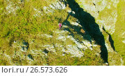 Купить «Orbital radial flight around young hiking man standing on top of the cliff. Looks away.», видеоролик № 26573626, снято 16 февраля 2017 г. (c) Александр Маркин / Фотобанк Лори