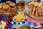 Hot dogs and burgers on wooden table with 4th july theme, фото № 26577054, снято 10 февраля 2017 г. (c) Wavebreak Media / Фотобанк Лори