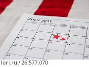 Calendar marked with star shape decoration. Стоковое фото, агентство Wavebreak Media / Фотобанк Лори