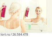 Купить «woman with hairspray styling her hair at bathroom», фото № 26584478, снято 13 февраля 2016 г. (c) Syda Productions / Фотобанк Лори