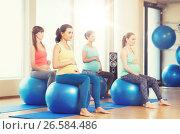 Купить «happy pregnant women exercising on fitball in gym», фото № 26584486, снято 5 марта 2016 г. (c) Syda Productions / Фотобанк Лори