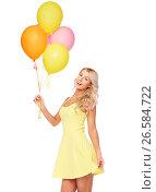 Купить «happy woman in dress with helium air balloons», фото № 26584722, снято 20 апреля 2017 г. (c) Syda Productions / Фотобанк Лори