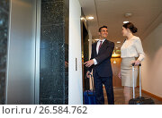 Купить «business team with travel bags at hotel elevator», фото № 26584762, снято 22 мая 2017 г. (c) Syda Productions / Фотобанк Лори