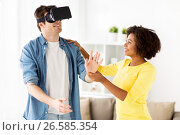happy couple with virtual reality headset at home. Стоковое фото, фотограф Syda Productions / Фотобанк Лори