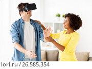 Купить «happy couple with virtual reality headset at home», фото № 26585354, снято 4 февраля 2017 г. (c) Syda Productions / Фотобанк Лори