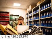 Купить «Frustrated businessman with pile of files and laptop», фото № 26585970, снято 26 ноября 2016 г. (c) Wavebreak Media / Фотобанк Лори