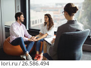 Купить «Couple talking to a marriage counselor», фото № 26586494, снято 23 ноября 2016 г. (c) Wavebreak Media / Фотобанк Лори
