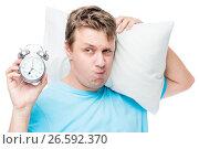 Unhappy portrait of a man sleepy with an alarm clock on a white background. Стоковое фото, фотограф Константин Лабунский / Фотобанк Лори