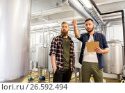 Купить «men with clipboard at craft brewery or beer plant», фото № 26592494, снято 24 марта 2017 г. (c) Syda Productions / Фотобанк Лори