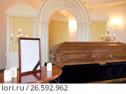 Купить «photo frame and coffin at funeral in church», фото № 26592962, снято 20 марта 2017 г. (c) Syda Productions / Фотобанк Лори